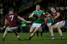 Donal Vaughan is tackled by Johnny Heaney and Thomas Flynn 2/3/2019