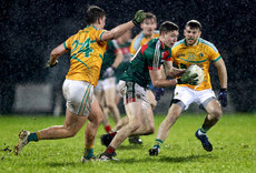 Niall McGovern and Conor Gallagher tackle Fionn McDonagh 10/1/2018