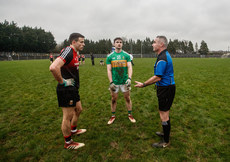 Jason Doherty and Ryan O'Rourke with referee James Molloy as he performs the coin toss for the penalty shoot out 6/1/2019