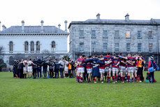 Dublin University and Clontarf team huddles after the game