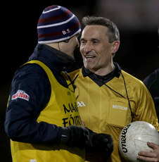Brian Silke talks with referee Maurice Deegan at half time 2/3/2019