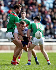 Conor McCarthy is tackled by Aidan O'Shea and Fergal Boland 24/3/2019