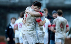 Niall Carson and David Joyce celebrate after the game