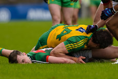 Diarmuid OÕConnor after a tackle from Michael Murphy 2/4/2017