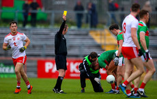 Kieran McGeary is yellow carded by referee Joe McQuillan 3/2/2019