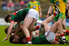 Diarmuid O'Connor on the ground as Aidan O'Shea tussles with Michael Murphy 2/4/2017