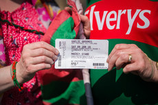 A Mayo fan with their ticket outside the Gaelic Grounds 9/6/2018