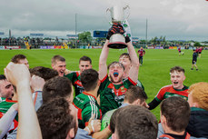 John Cunnane lifts the trophy 17/6/2018
