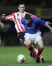Setanta Cup 20/2/2006. Linfield vs Derry city. Linfield\'s James Ervin gets around Mark Farren of Derry city. Mandatory credit INPHO/Lorraine O\'Sullivan